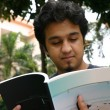Young man reading 2 — Stock Photo