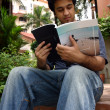 Young man reading 3 — Stock Photo