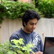Young man using a laptop 5 — Stock Photo