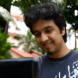 Stockfoto: Young musing laptop 2