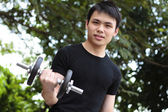Young man exercising — Stock Photo