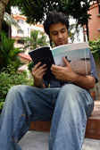 Young man reading 3 — Stockfoto