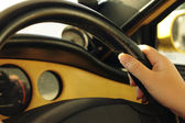 Hand on steering wheel — Stockfoto