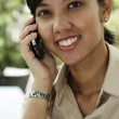 Female executive speaking on the phone — Stock Photo