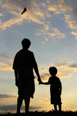Silhouette of a father and son — Stock Photo