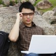 Stock Photo: Young mwith laptop