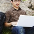 Young man with laptop — Stock fotografie #2580523