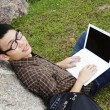 Young man with laptop — 图库照片