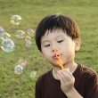 Young boy with bubbles — Foto Stock