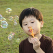 Young boy with bubbles — Stok fotoğraf