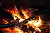 Burning coals in a fireplace — Stock Photo