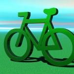 Green metallic bicycle on the grass — Stock Photo