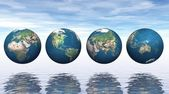 Continents on four earth — Stock Photo