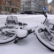 Stock Photo: Fallen bicycle covered by snow