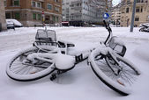 Fallen bicycle covered by snow — Stock Photo