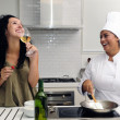 Cookery course: woman drinking wine — Foto de Stock