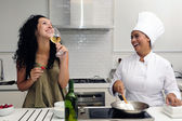 Cookery course: woman drinking wine — Stock Photo