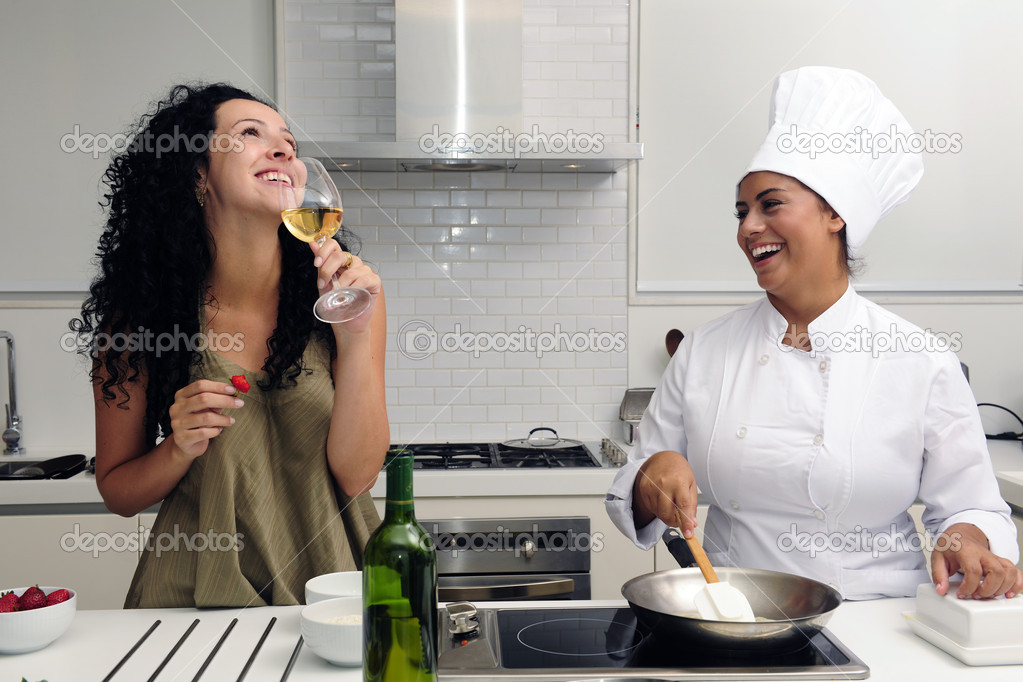 Cookery course:  woman drinking wine while chef cooking risotto  Stock Photo #2106811