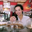 Owner of a small business cafe - Foto Stock