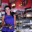 Owner of a small business cake store — Stockfoto