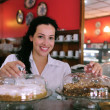 图库照片: Waitress of pastry store/ cafe