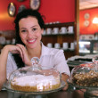 Foto Stock: Owner of a small business store cafe