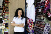 Happy owner of a fabric store — Stock Photo