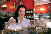 Waitress of a pastry store/ cafe — Stock Photo