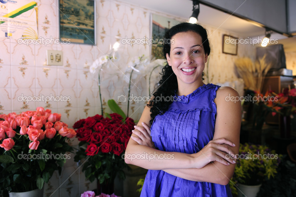 Small business: happy owner of a flower shop — Stock Photo #2158752