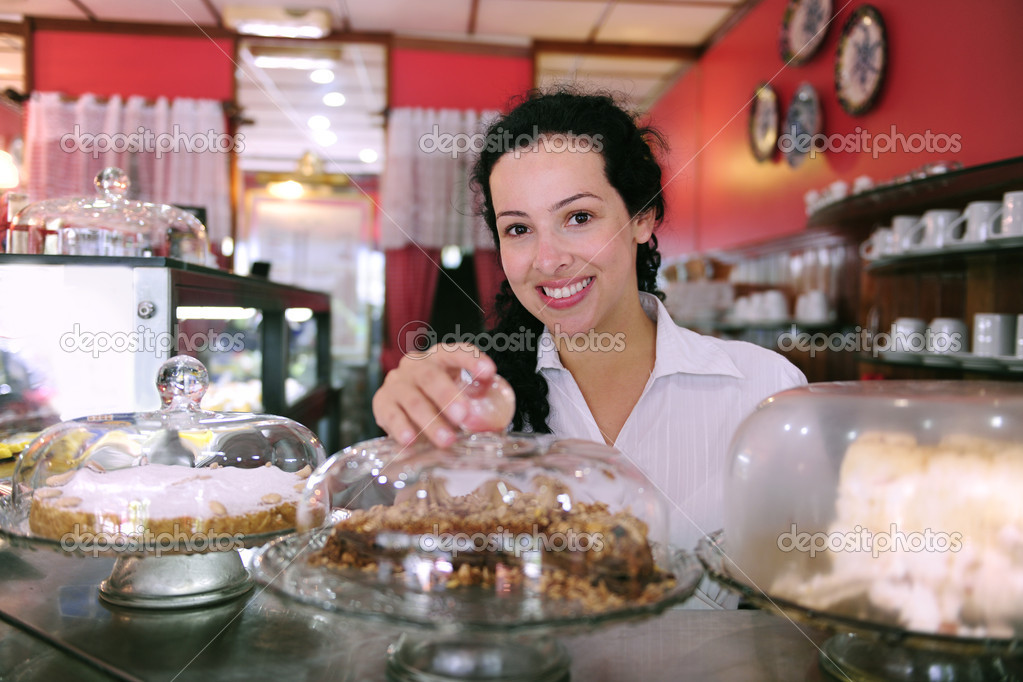 Owner of a small business store showing her tasty cakes — Foto Stock #2158817