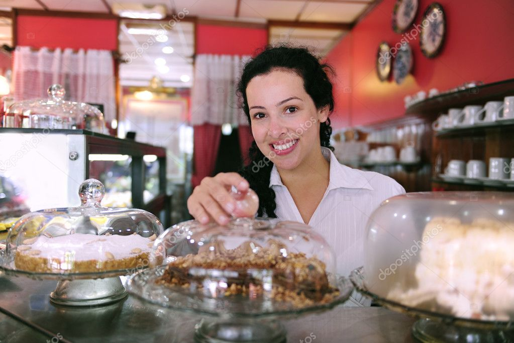 Owner of a small business store showing her tasty cakes — Stok fotoğraf #2158817