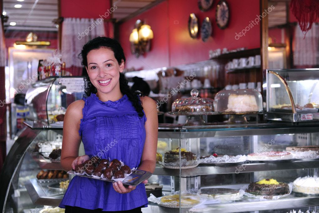 Owner of a small business store showing her tasty cakes — Stok fotoğraf #2158852