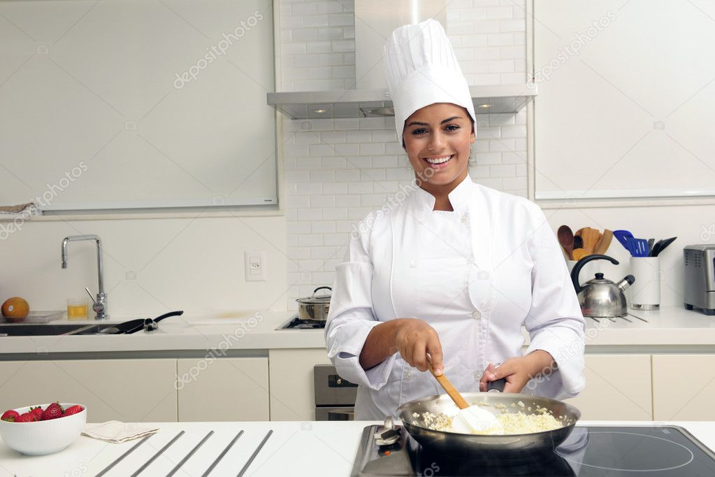Chef cooking a tasty  risotto  in a modern kitchen — Stock Photo #2158927