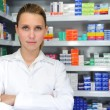 Foto Stock: Female pharmacist at pharmacy