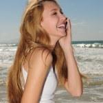 Woman talking on phone on the beach — Stock Photo