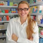 Female pharmacist at pharmacy — Stock Photo