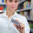 Stock Photo: Pharmacist selling medicine