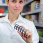 Pharmacist selling medicine — Stock Photo