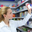 Pharmacist searching the right medicine - Foto Stock