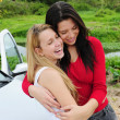 Two happy women on car trip — Stock Photo