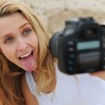 Woman taking a self-portrait — Stock Photo
