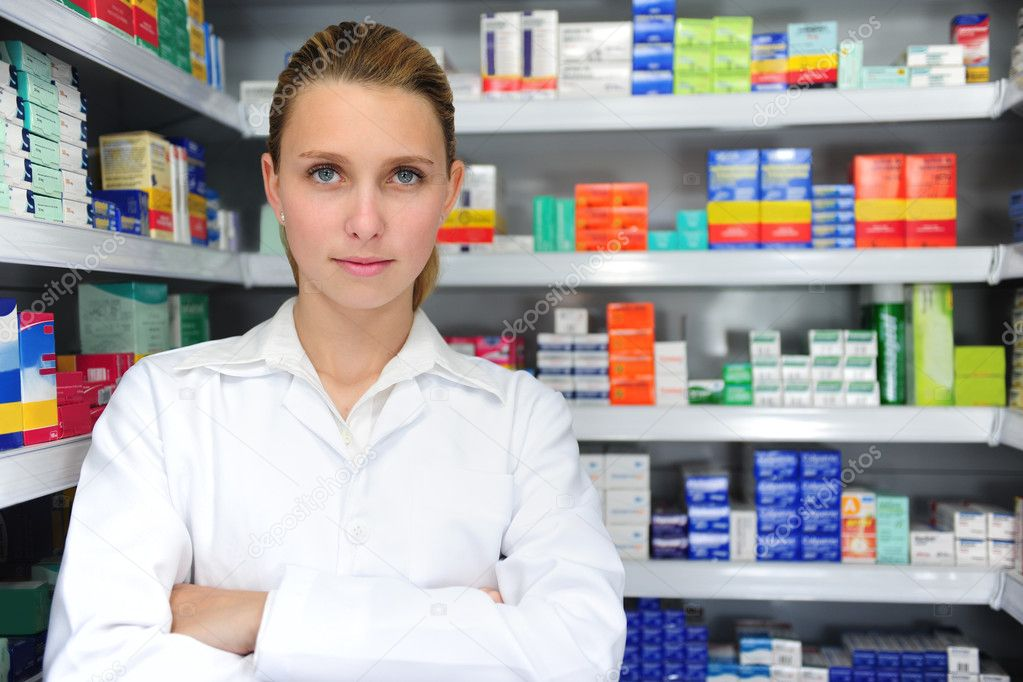 Portrait of a female pharmacist at pharmacy — Stock Photo #2281938
