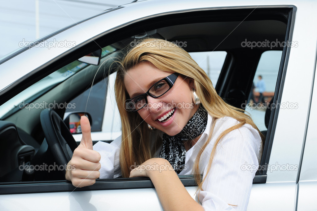 Happy woman driving a new car — Stock Photo #2285037