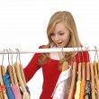 Teenage girl shopping for clothes — Stock Photo