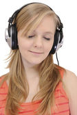 Teenage girl listening to music — Stock Photo