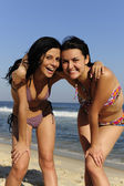 Two happy girl friends on the beach — Stock Photo