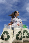 Recycling: woman holding bag — Stock Photo
