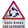 Stock Photo: Give way at roundabout french traffic sign