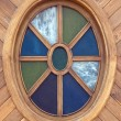 Oval wooden window — Stock Photo