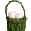 Eggs in a basket - Stock Photo